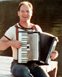 Uncle Roy playing accordion on float.