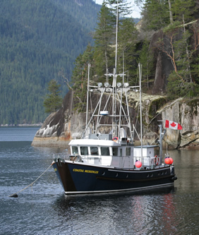 Coastal Messenger tied to mooring buoy in Desolation Sound.