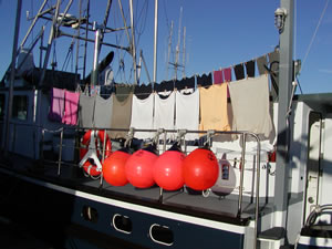 Hanging laundry to dry on the Coastal Messenger.